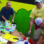 Volunteers paint at TCRC