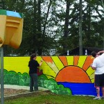 Brightening up the TCRC mural.