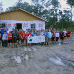 The group in front of the house in progress.